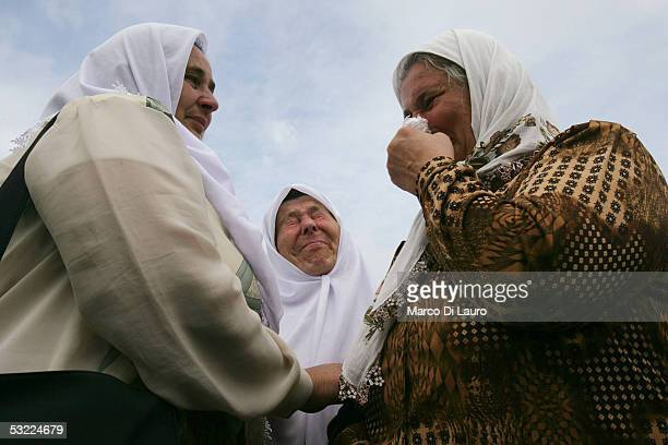 SREBRENICA BOSNIA HERZEGOVINA JULY 11 Relatives of the Srebrenica massacre victims cry during the funeral of their family members at the Srebrenica...