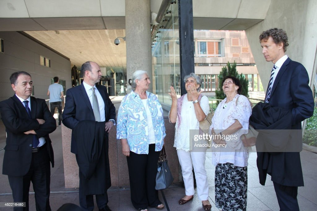 Relatives of the Srebrenica victims and members of ''Mothers of Srebrenica'' association react outside after Dutch court announced of the verdict in a case against the Dutch government in The Hague, Netherlands on July, 16 2014. Dutch court rules the Netherlands is liable for the 1995 massacre of Bosnians at Srebrenica.