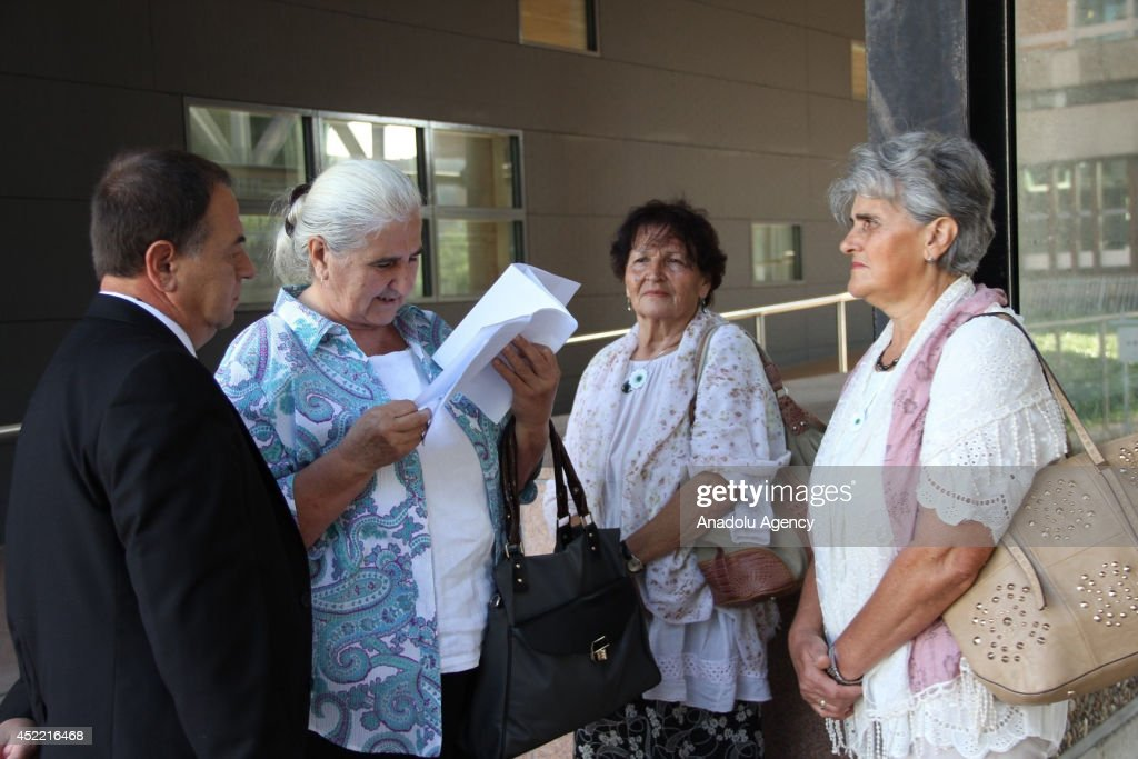Relatives of the Srebrenica victims and members of ''Mothers of Srebrenica'' association stand outside after Dutch court announced of the verdict in a case against the Dutch government in The Hague, Netherlands on July, 16 2014. Dutch court rules the Netherlands is liable for the 1995 massacre of Bosnians at Srebrenica.