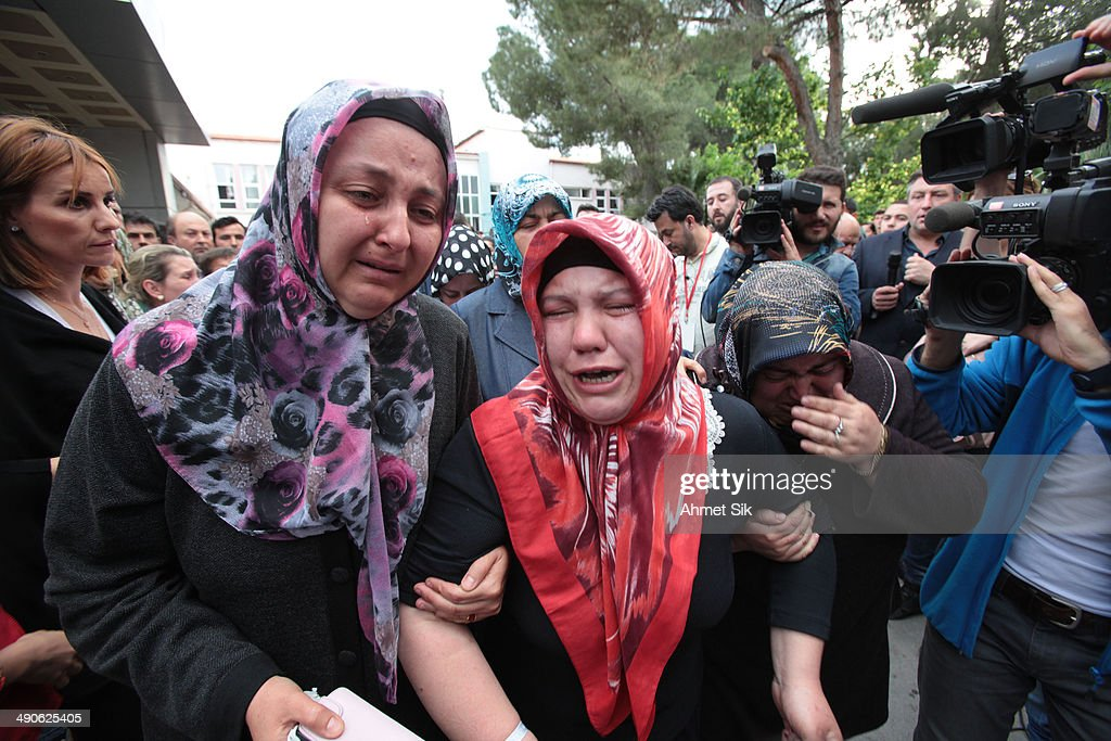 Relatives of the trapped miners react near the mine May 15 2014 in Soma a district in Turkey's western province of Manisa Turkey An explosion and...