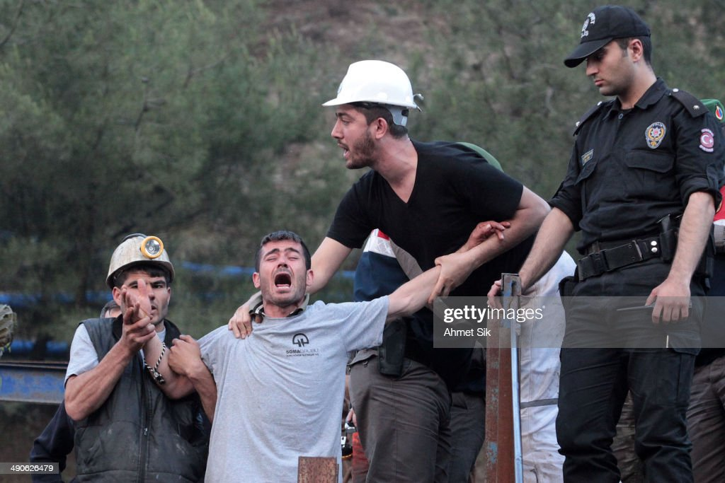 Relatives of the trapped mines react infront of the mine May 15 2014 in Soma a district in Turkey's western province of Manisa An explosion and fire...