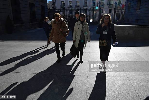 Relatives of the victims in the 2003 Yakovlev 42 air disaster arrive to the Congress Palace in Madrid on January 16 2017 to listen to the...