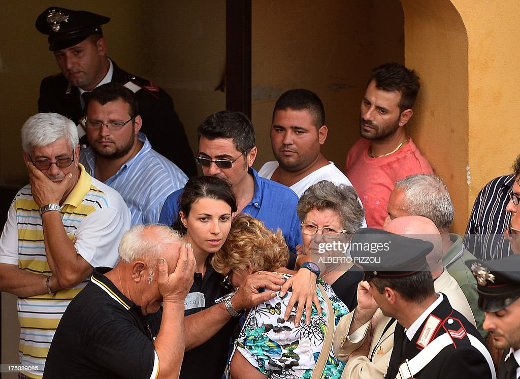 Relatives of the victims of a bus crash on the road between Monteforte Irpino and Baiano mourn on July 29, 2013, near the morgue in Monteforte Irpino, southern Italy. A coach carrying pilgrims plunged off a motorway flyover near Naples in southern Italy, killing at least 39 people in one of the worst such accidents in Europe in recent years.