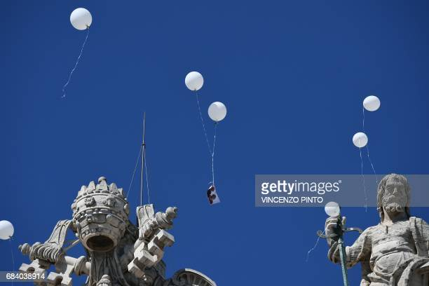 TOPSHOT Relatives of the victims of the Hotel Rigopiano hit by an avalanche last January killing 29 people release white balloons in the sky during a...