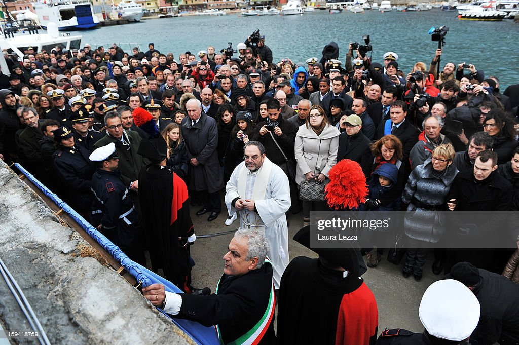 Relatives of the victims of the sunken Costa Concordia attend an unveiling of a memorial plaque bearing their names, on January 13, 2013 in Giglio Porto, Italy. A year after the sinking of the ship Costa Concordia, relatives of the victims, survivors, island residents, law enforcement and institutions gathered to mark the first anniversary and commemorate the dead. More than four thousand people were on board when the ship hit a rock off the Tuscan coast, killing 32 and leaving two people missing.