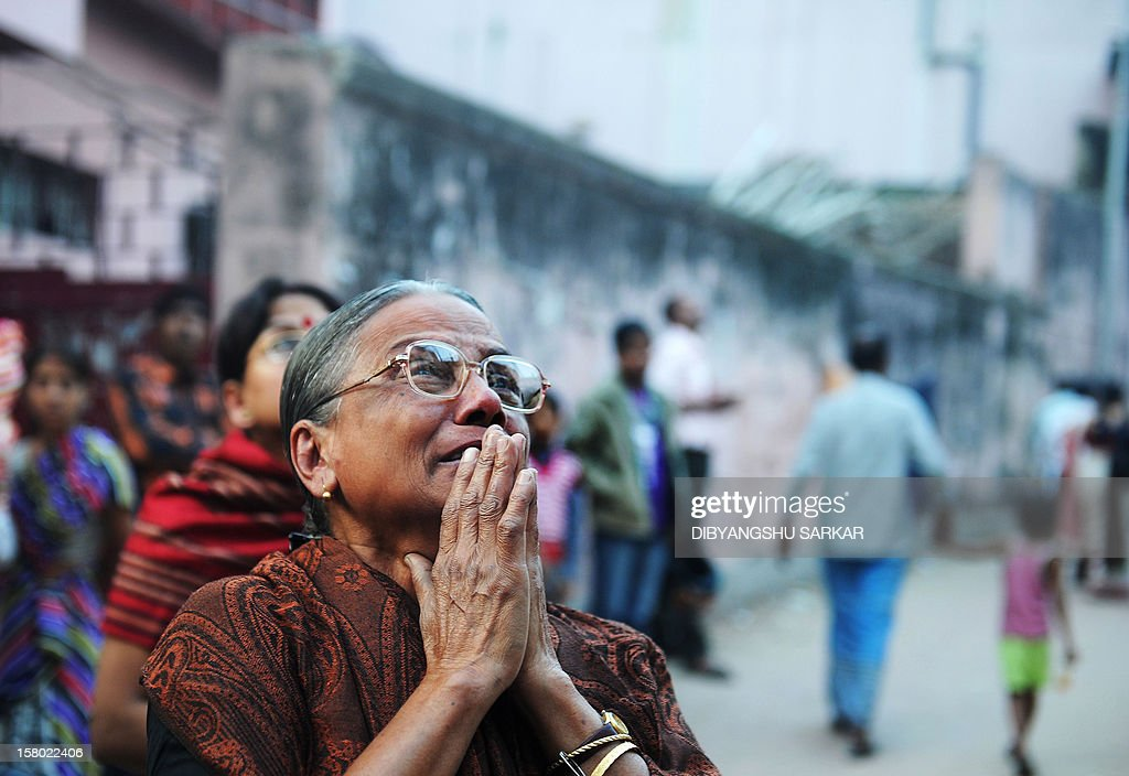 Relatives of the victims who lost their lives in a fire at the Advanced Medicare and Research Institute(AMRI) hospital grieve during a silent protest rally to mark the first anniversary of the accident in Kolkata on December 9, 2012. Ninety three people lost their lives in the worst ever hospital disaster in the country during a devastating fire at the seven-storey building of AMRI, a premier private hospital of the city with mostly patients of ICCU, ICU, Intensive Therapy Unit and Critical Care units and orthopaedic department being asphyxiated to death. AFP PHOTO/Dibyangshu SARKAR