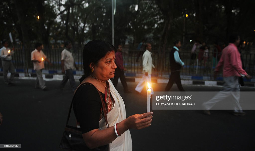 Relatives of the victims who lost their lives in a fire at the Advanced Medicare and Research Institute(AMRI) hospital walk during a silent protest rally to mark the first anniversary of the accident in Kolkata on December 9, 2012. Ninety three people lost their lives in the worst ever hospital disaster in the country during a devastating fire at the seven-storey building of AMRI, a premier private hospital of the city with mostly patients of ICCU, ICU, Intensive Therapy Unit and Critical Care units and orthopaedic department being asphyxiated to death. AFP PHOTO/Dibyangshu SARKAR