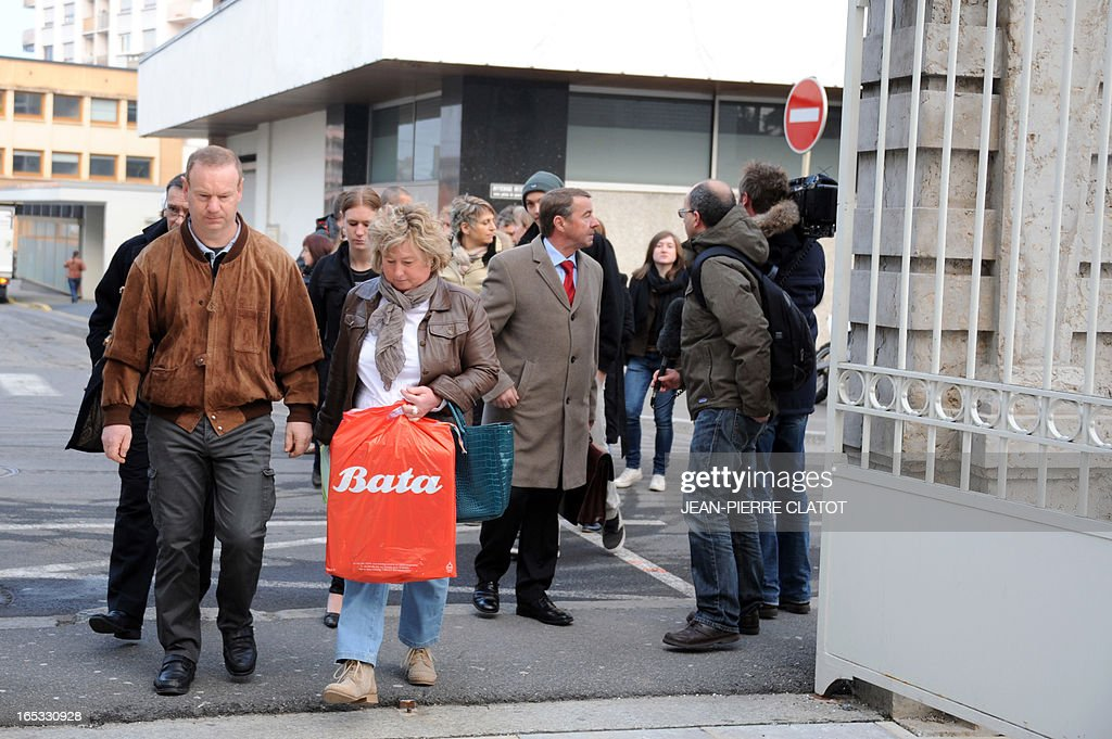 Relatives of the victims, who were killed when their school bus was hit on June 2, 2008 by a train on a railway crossing in the eastern French town of Allinges, arrive on April 3, 2013 at the courthouse for the opening of the trial in the Alpine city of Thonon-les-Bains. School bus driver Jean-Jacques Prost, the state-owned railway company SNCF and rail operator Reseau Ferre de France are charged with involuntary homicides after a train hit the school bus carrying teenagers, killing seven students and wounding 25. One of the teachers, who survived the crash, later committed suicide.