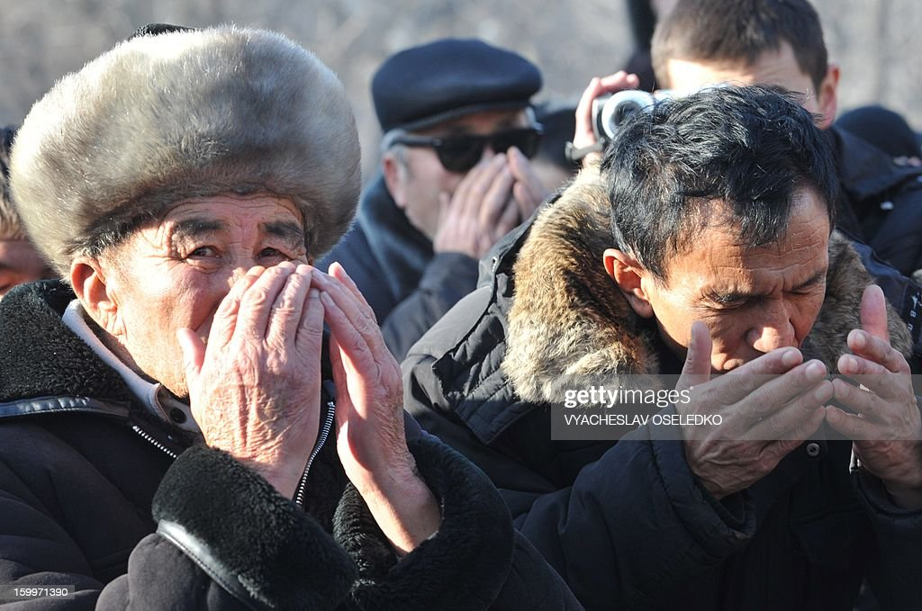 Relatives of those who were killed during the April 2010 uprising that ousted president Kurmanbek Bakiyev and installed a new government pray during a rally just outside the government headquarters in the Kyrgyzstan's capital Bishkek on January 24, 2013. The rally participants demanded today the arrest of all those responsible for the April 2010 killings.