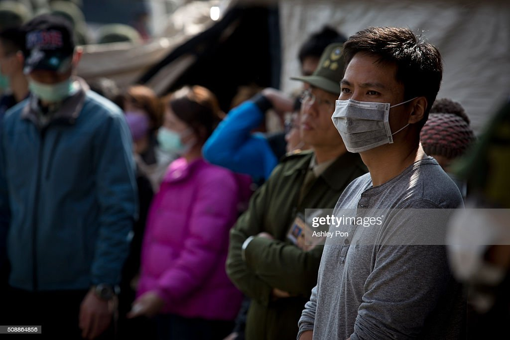Relatives of trapped residents waiting while the rescue operation continues on February 6, 2016 in Tainan, Taiwan. A magnitude 6.4 earthquake hit southern Taiwan early Saturday, toppling several buildings, killing at least fourteen people, and leaving over one hundred missing in Tainan.