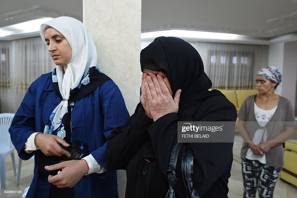 Relatives of Tunisian doctor Fathi Bayoudh, who was killed in the Istanbul airport attack blamed on the Islamic State (IS) group on June 28, attend a mourning ceremony in Tunis on June 30, 2016, ahead of his funeral. Bayoudh, who was killed in the Istanbul airport attack, was in Turkey to secure the release of his son detained for joining the jihadists, diplomats said on June 30, 2016. / AFP / FETHI