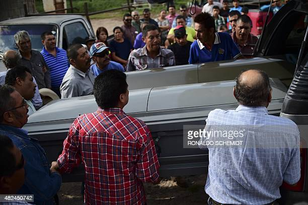 Relatives of two victims of the truck accident carry the coffins in Santa Rosa town in Zacatecas State on July 30 2015 A truck plowed into a crowd of...