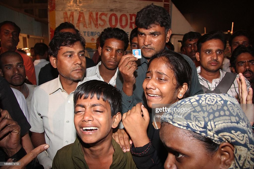 Relatives of victims crying after seven floor under-construction building collapsed at Lucky compound on April 4, 2013 in Thane, India. The death toll has risen to 39 while at least 69 people are injured. The building is illegal and constructed on Forest land. Police have registered a case against builders Salil and Khalil Jamadar under Section 304.