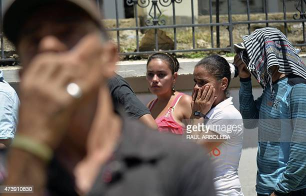 Relatives of victims mourn outside the cemetery after a landslide in Salgar municipality Antioquia department Colombia on May 18 2015 A massive...