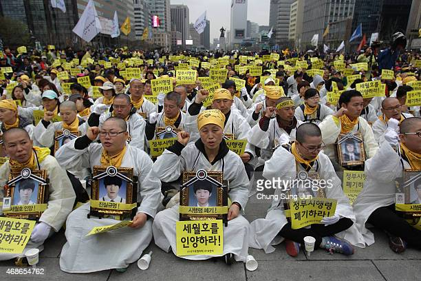 Relatives of victims of the Sewol ferry hold portraits of victims during their rally on April 5 2015 in Seoul South Korea Relatives students and...