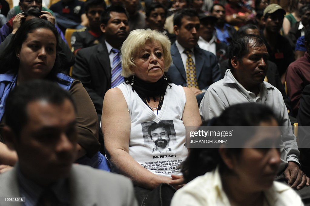 Relatives of victims of the slaugther of the villa Dos Erres are seen in a hearing at the Supreme Court of Justice in Guatemala City on January 11, 2013, in which they requested that an amnesty application for Guatemalan former de facto president (1982-1983) and retired General, Jose Efrain Rios Montt, who is facing genocide charges for abuses committed during his military dictatorship, be rejected. The case involves the massacre of 201 peasant farmers in the village of Dos Erres during a military operation December 6-8, 1982 in Peten, 600 km north of Guatemala City. AFP PHOTO/Johan ORDONEZ