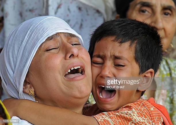 Relatives of Yasir Rafiq Sheikh a cousin of senior separatist leader Yasin Malik who was seriously injured by police gunfire cry in Srinagar on...