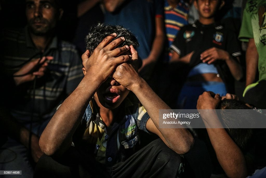 Relatives of Zine al-Umur, 55, who lost her life after Israeli warplanes bombed around Gaza's southern, during a funeral ceremony in east of the Rafah city, Gaza on May 5, 2016.
