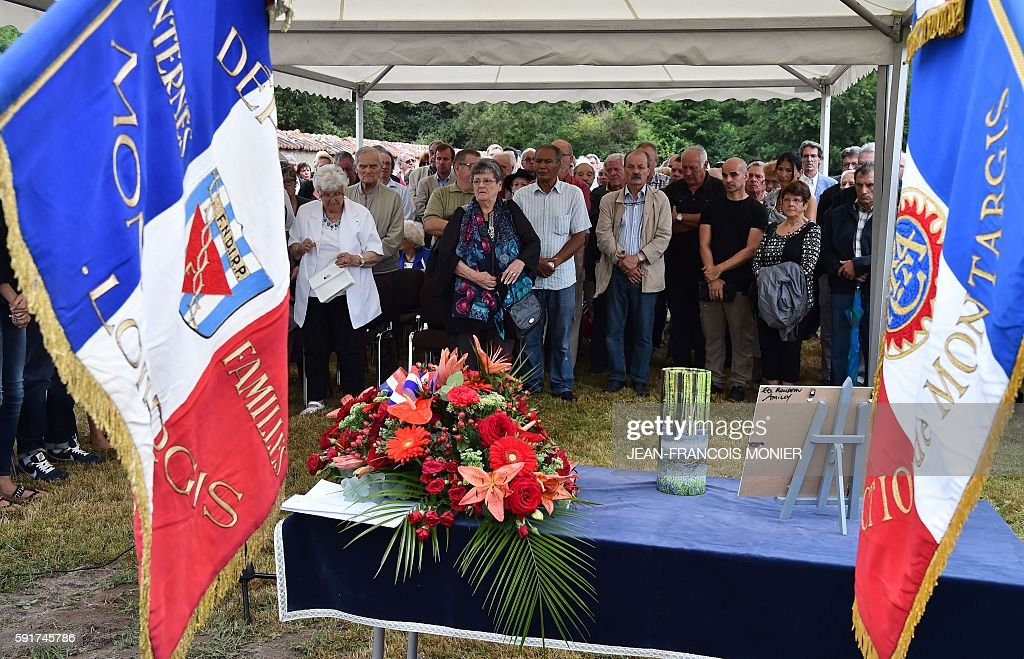 Relatives pay honor in front of the urn during the funeral of Georges Seguy former secretary general of French major union CGT at the cemetery of...
