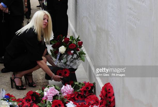 Relatives pay their respects after a Ceremony to mark the addition of the names of 67 members of the Armed Forces who were killed on duty or as a...