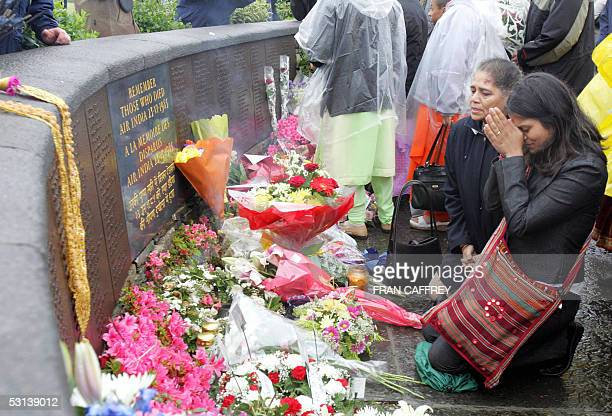 Relatives pray at the Memorial commemorating the 20th Anniversary of the Air India disaster 23 June 2005 in Ahakista Cork Ireland Canadian Prime...