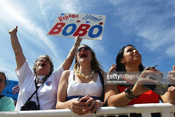 Relatives shout to sailors on the flight deck during the homecoming of the USS Enterprise at the Norfolk Naval Station July 15 2011 in Norfolk...