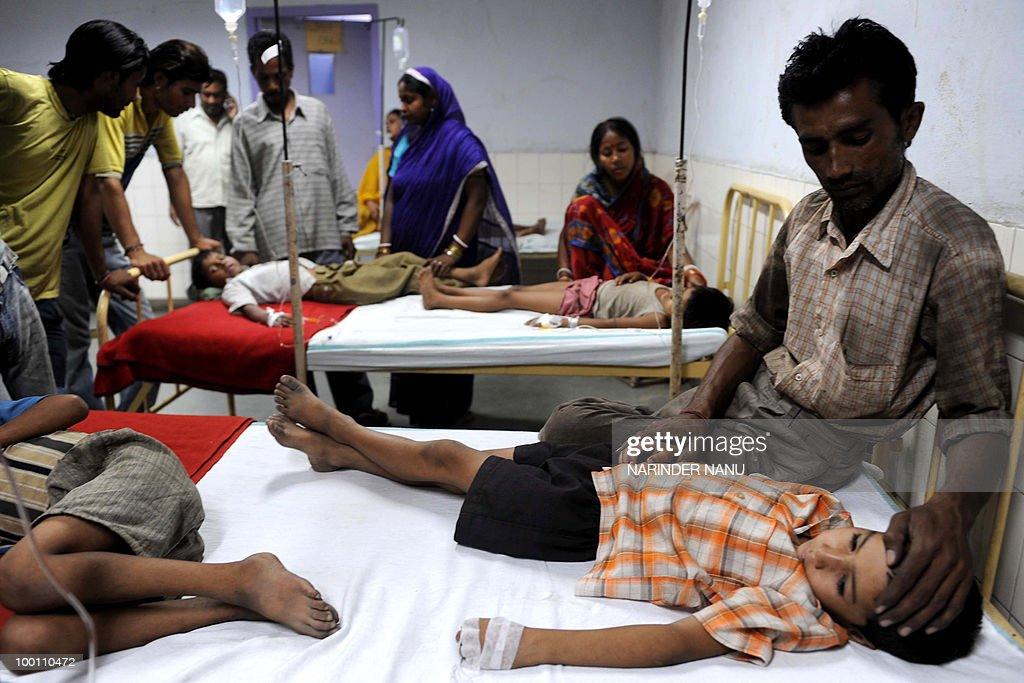 Relatives sit with their children at the Civil hospital in Amritsar on May 21, 2010, after they took medicine of allegedly poor quality . Twenty three students of a Government Secondary School were admitted to the Civil hospital after taking calcium and iron tablets distributed by school staff supplied by the National Rural Health Mission.