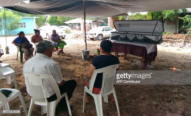 Relatives wake a victim of 61 earthquake in Ixtlatepec Oaxaca state Mexico on September 23 2017 Efforts to find life under the rubble of buildings in...