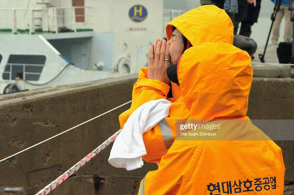 Relatives weep as they wait for missing passengers of a sunken ferry at Jindo port on April 18, 2014 in Jindo-gun, South Korea. Twenty-eight people are confirmed dead, and 268 are missing as reported. The ferry identified as the Sewol was carrying about 470 passengers, including the students and teachers, traveling to Jeju Island.