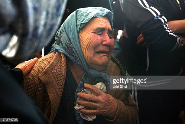 Relatives weep at the funeral for Herzl Shlomo a victim of the Karni crossing suicide attack on January 14 2005 in Sderot Israel All border crossing...