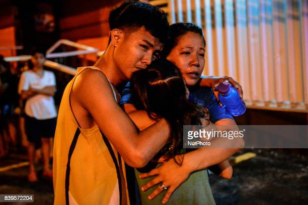 Relatives weep near the scene where a man was killed by an unknown assailant in Mandaluyong Metro Manila Philippines August 19 2017 Amidst the drug...