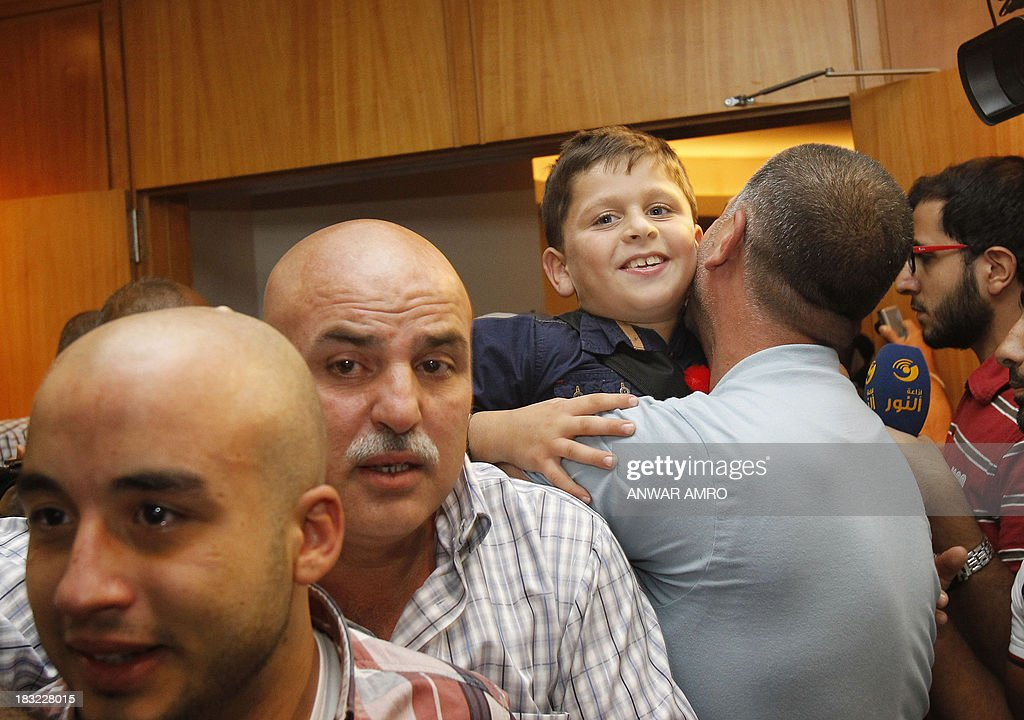 Relatives welcome the Lebanese survivors of the migrant shipwreck in Indonesia last week upon their arrival at Beirut airport on October 6, 2013. Lebanese asylum-seekers who died when a boat sank off Indonesia were the victims of people smugglers who prey on them and Syrian refugees seeking to better their lives.