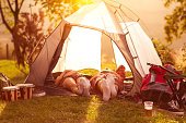 Couple sleeping in tent at early morning sun