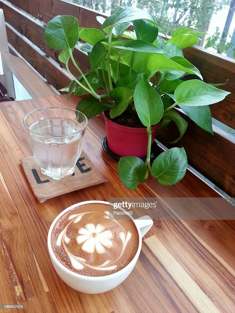 Relax with a cup of coffee with flower clatte art : Stock Photo