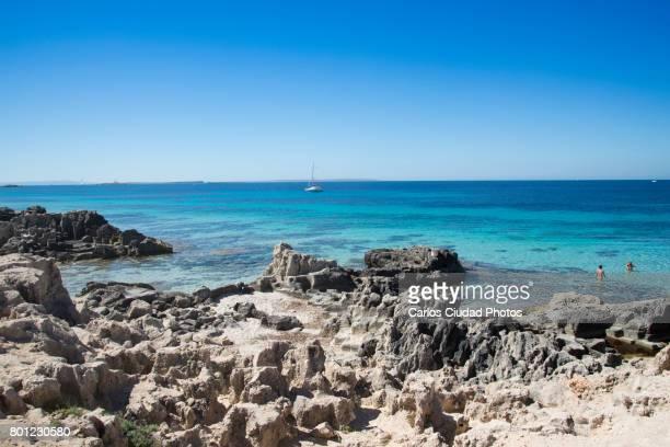 Relaxation in Las Salinas Beach during summer, Ibiza, Spain