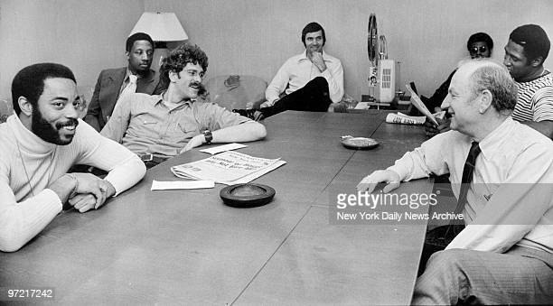 A relaxed bunch of New York Knicks sit around projector with their coach Red Holzman at Madison Square Garden where they're hoping to wind up NBA...