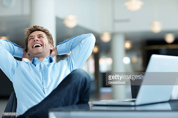 Relaxed business man laughing