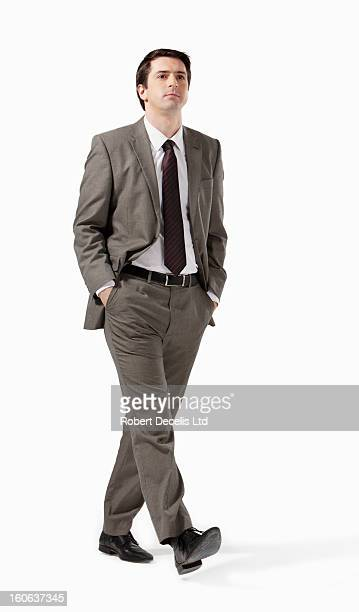Relaxed business man walking towards camera