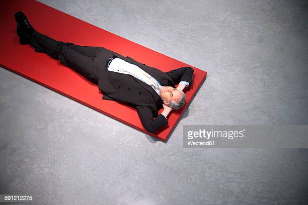 Relaxed businessman lying on floor