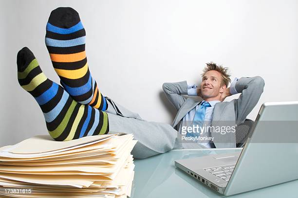 Relaxed Businessman Office Worker Smiling With Colorful Socks on Desk