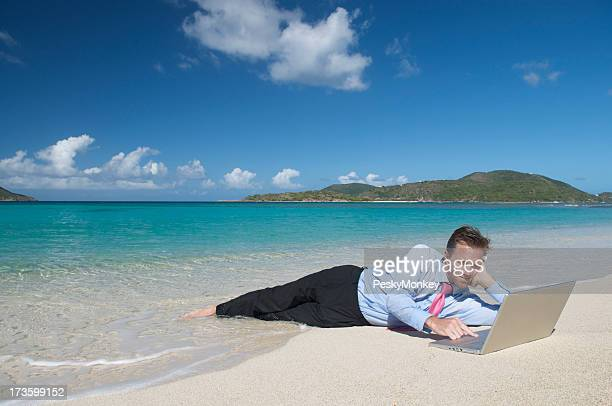 Relaxed Businessman Surfing the Web on Tropical Beach