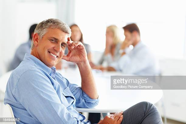 Relaxed businessman with hand on head