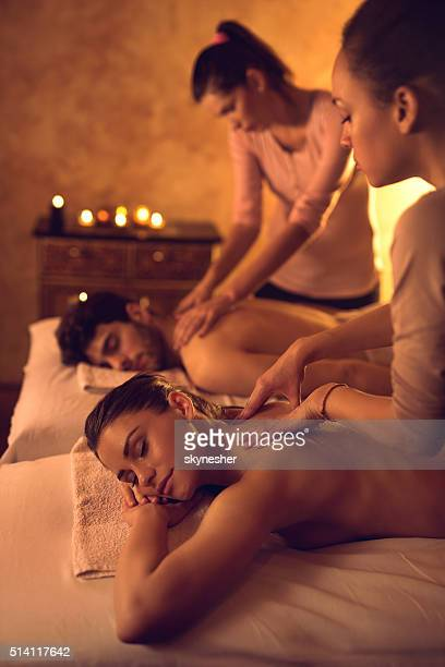 Relaxed couple enjoying during back massage at the spa.
