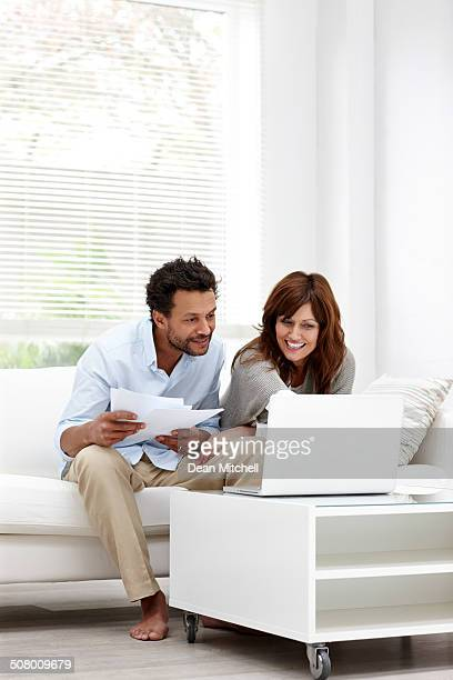 Relaxed couple using laptop for information
