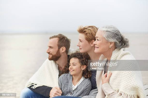 Relaxed extended family on the beach