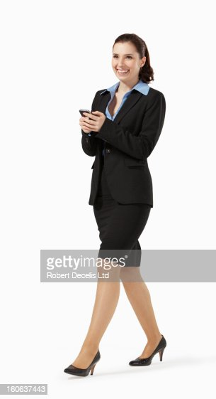 Relaxed happy business woman on smart phone : Bildbanksbilder