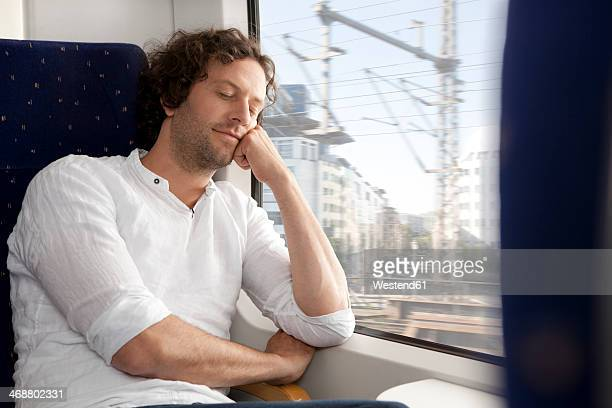 Relaxed man in a train
