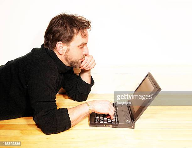 Relaxed man working on his laptop