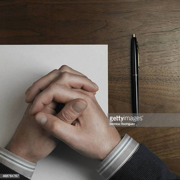 Relaxed Man's hands on paper