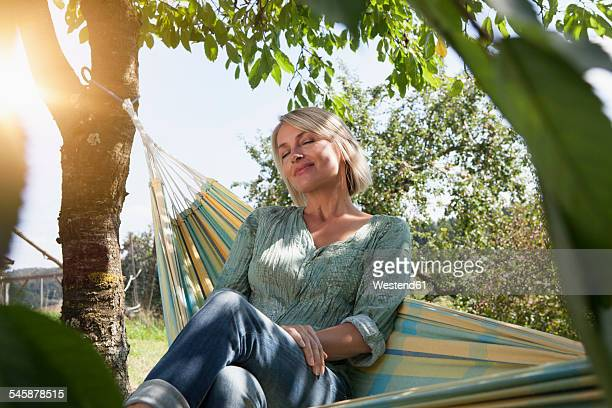 Relaxed mature woman in hammock